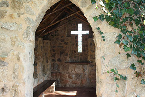 the intimate stone chapel at Ekukhanyeni, which overlooks a stunning valley below.