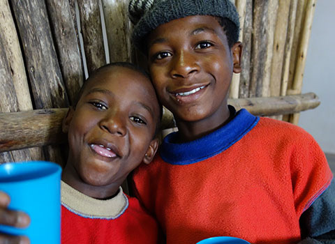 two happy African children together at Ekukhanyeni