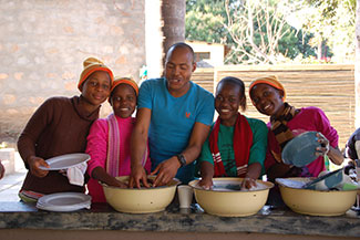 a group of youths taking cooking lessons from a facilitator at Ekukhanyeni