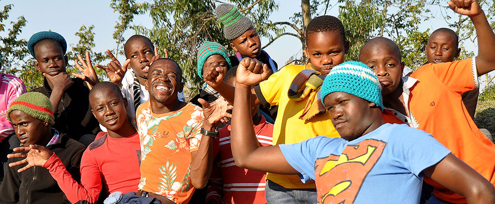 a group of happy youths, dancing and having fun together at Ekukhanyeni